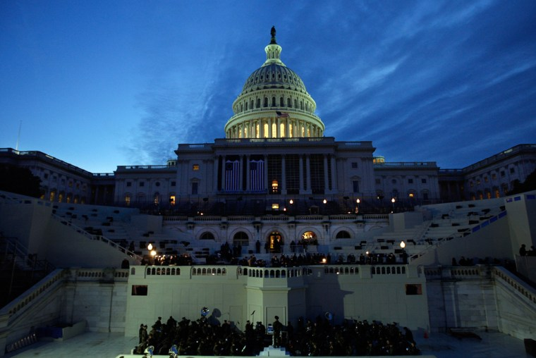 Image: The early morning sky brightens on the West Front of the Capitol during a rehearsal for the Inauguration Ceremony in Washington
