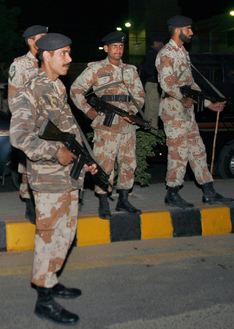 Image: Pakistani paramilitary troops stand guard at a road leading to U.S. Consulate in Karachi, Pakistan