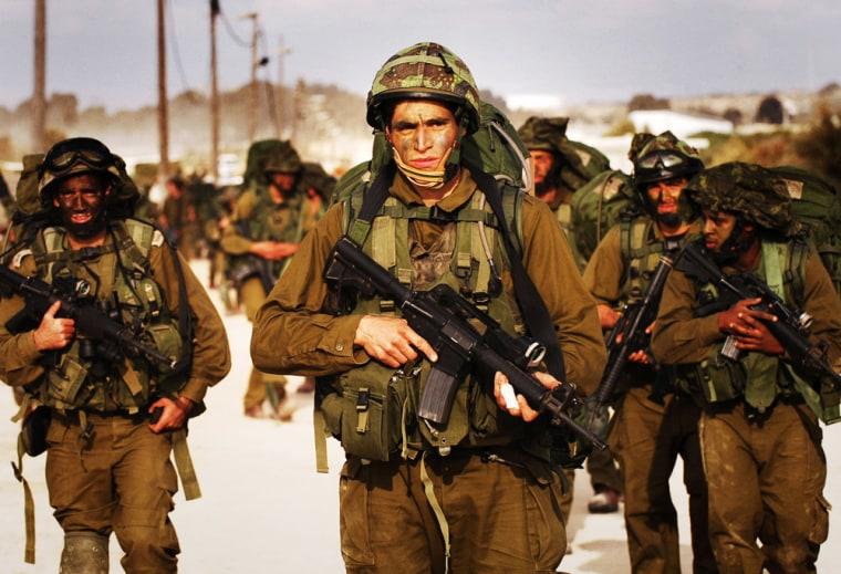 Image: Israeli soldiers walk towards the northern Gaza