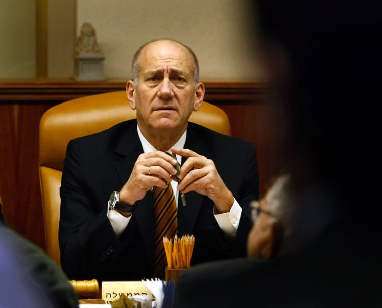 Israeli Prime Minister Ehud Olmert, shown at acabinet meeting in Jerusalem on Sunday, Jan. 11, 2009 is at a crossroads in the Gaza Strip offensive.
