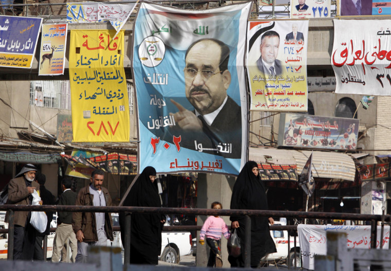 Imaage: Campaign posters for the upcoming provincial election are seen in Basra