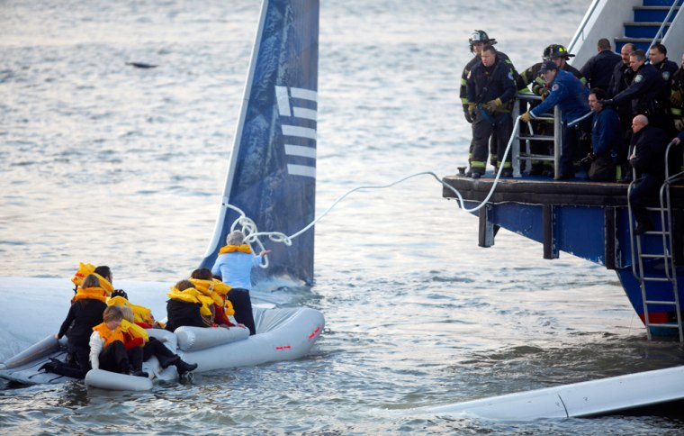 Image: Passengers are rescued after a U.S. Airways plane landed in the Hudson River