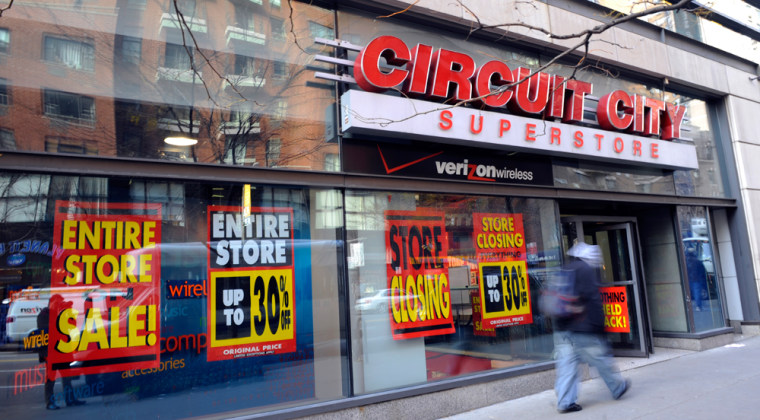 Image: People walk by Circuit City