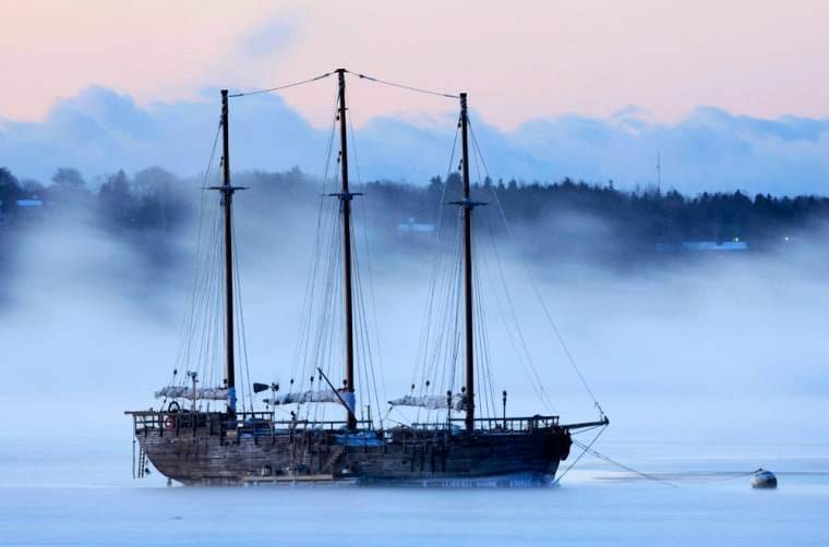 Arctic sea smoke drifts by Raw Faith, an 88-foot galleon, on a minus-12 degree morning on Friday in Rockland, Maine.