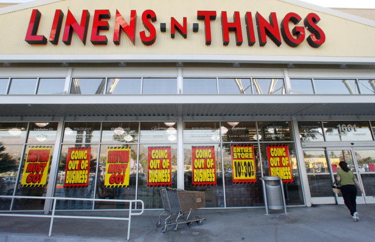 A woman walks into a Linens 'n Things store in Burbank