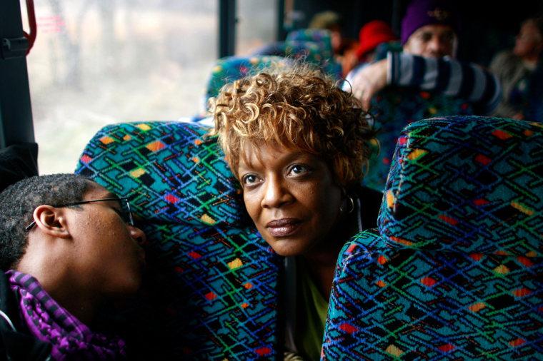 Image: bus riders to inauguration