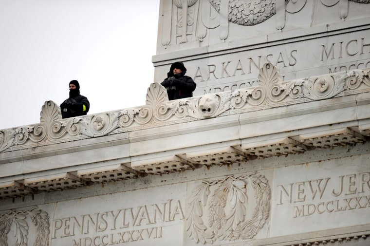 Image: Security agents watch the crowd