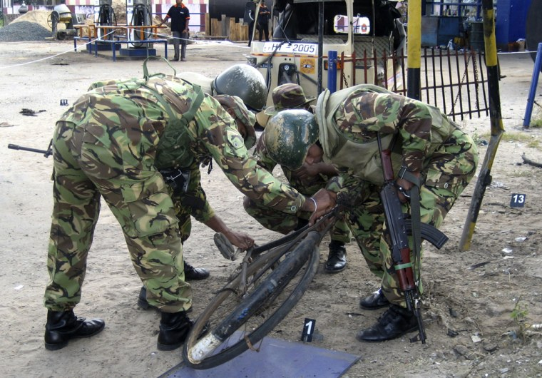 Image: Special Task Force soldiers inspect the wreckage of a bicycle