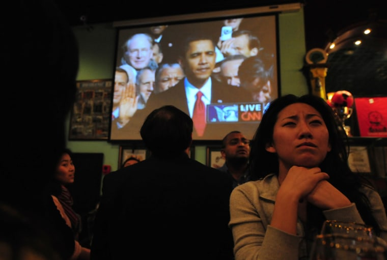 Image: A woman watches the inauguration of US President Barack Obama
