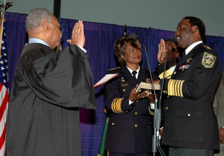 Val Demings, 51, is Orlando's police chief, and Jerry Demings, 49, right, is sheriff of Orange County.