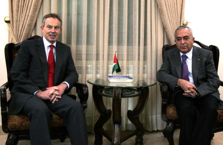 Image: Palestinian Prime Minister Salam Fayyad, right, meets with Middle East Quartet envoy and former British Prime Minister Tony Blair in the west bank city of Ramallah