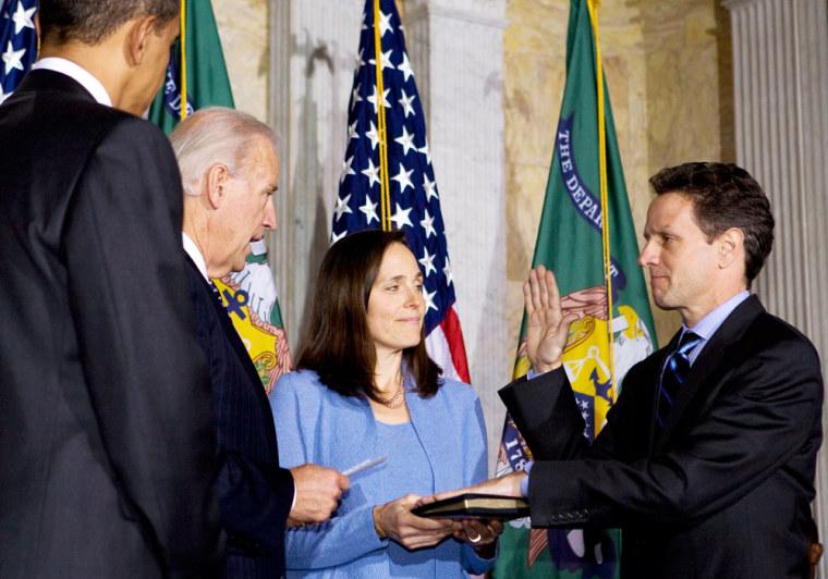 U.S. President Obama watches as Timothy Geithner is sworn in as Treasury Secretary in Washington