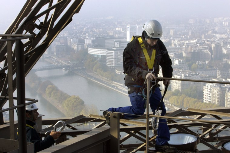 Image: electricians on the Eiffel Tower