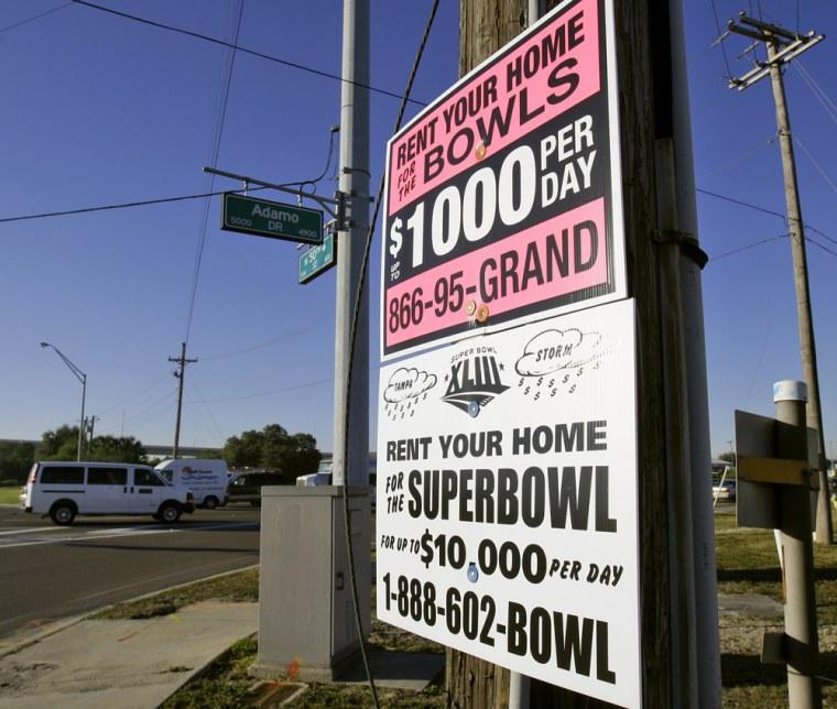 Image: signs hangi on a utility pole