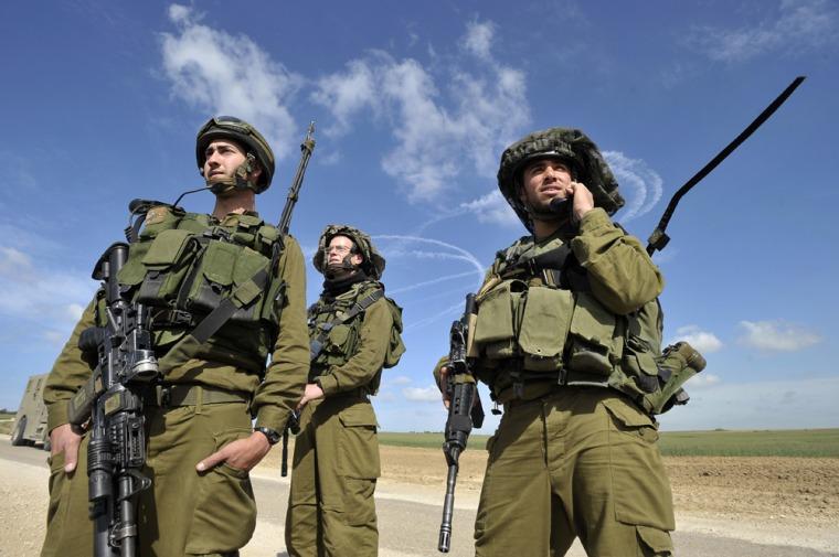 Image: Israeli soldiers patrol near the Israel-Gaza border