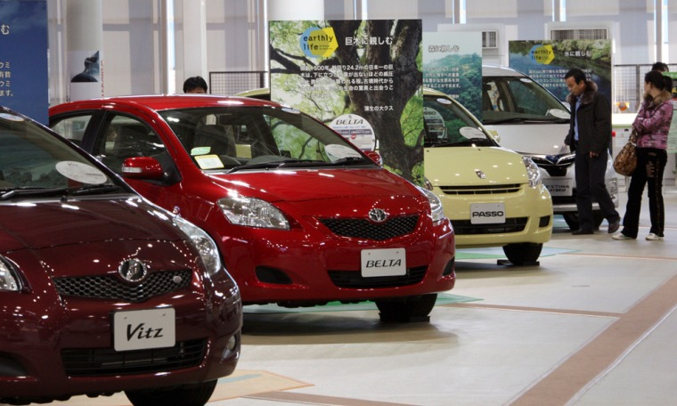 Image: Visitors look at the models of Toyota Motor Corp. vehicles