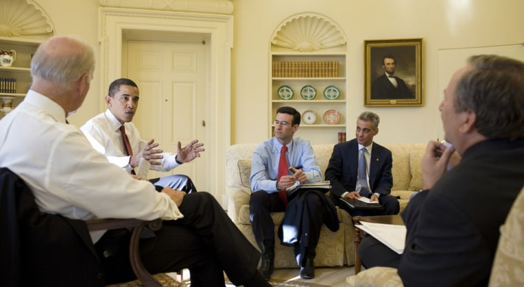 Image: Barack Obama with staff in the Oval Office