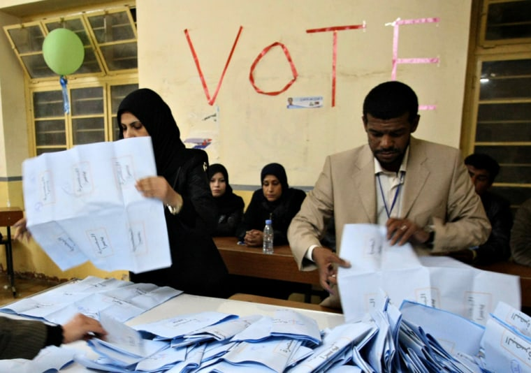 Iraqi electoral workers empty ballot boxes at the end of a day of voting in provincial elections in the southern city of Basra on Saturday. Voting in Iraq's provincial elections began amid tight security in the nation's first ballot since 2005.