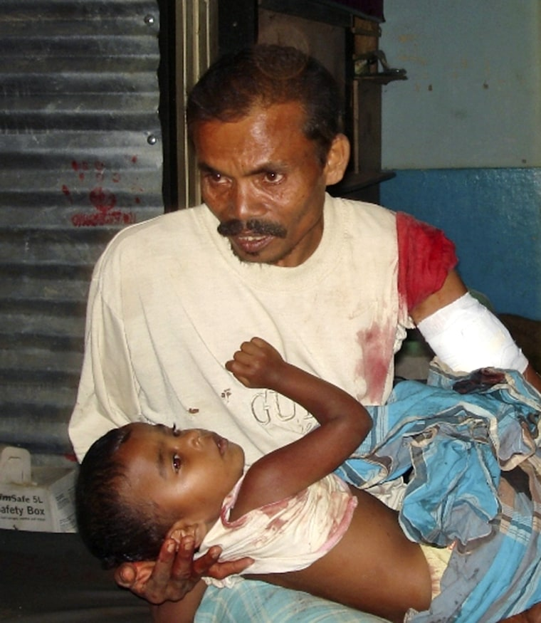 Image: Tamil man holds his son