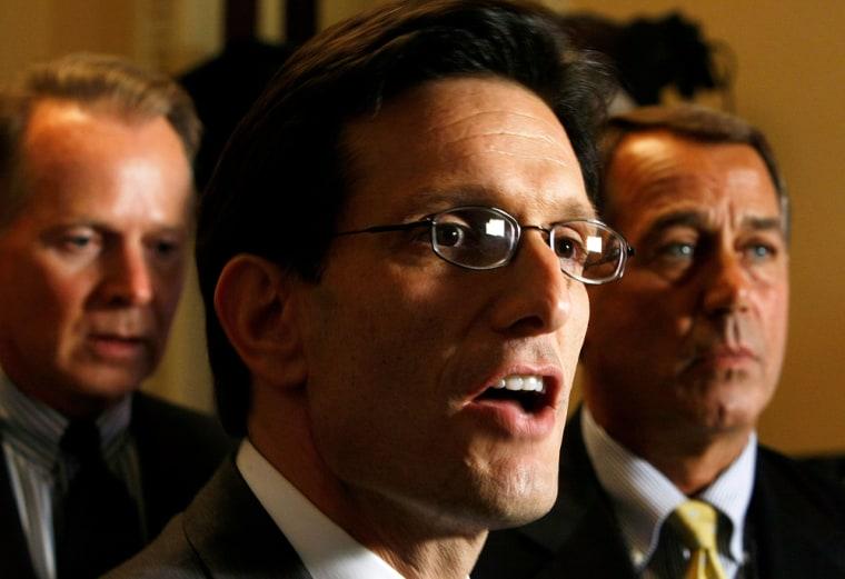 Image: U.S. House Minority Whip Rep. Eric Cantor (R-VA) (C) speaks as House Minority Leader Rep. John Boehner (R-OH) (R) and Rep. David Drier (R-CA) (L) listen