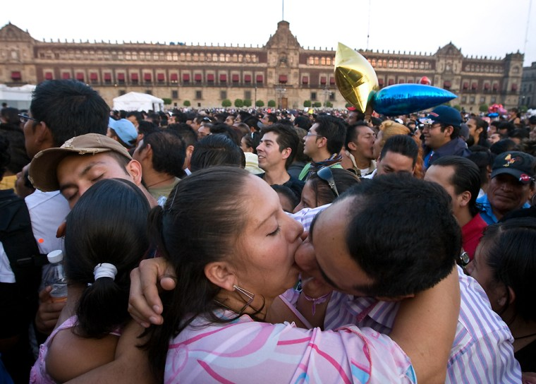Mexican couples kiss at the Zocalo square in Mexico City, on Saturday during a Valentine's Day attempt to break the Guinness record for simultaneous kisses. They succeeded.
