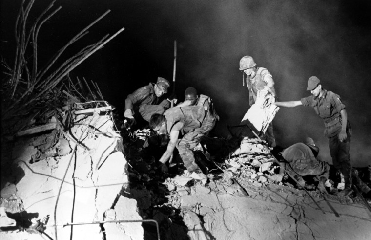 In this Oct. 24, 1983 file photo, U.S. Marines and an Italian soldier, right, dig through the rubble of the Battalion headquarters in Beirut, Lebanon, the scene of a suicide car bomb attack against the U.S. Marine barracks which occurred Sunday morning, Oct. 23, killing 241 servicemen.