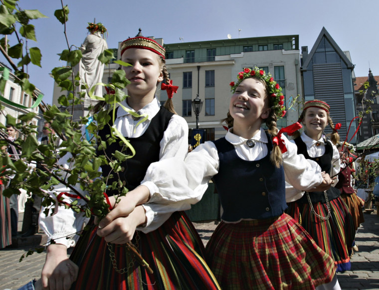 Young Latvian dancers perform a traditional dance marking the arrival of summer in2006 in old Riga, Latvia.