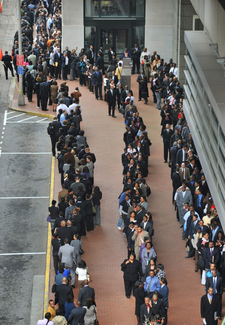 Image: Thousands of people line up at a federal government job fair in downtown Atlanta
