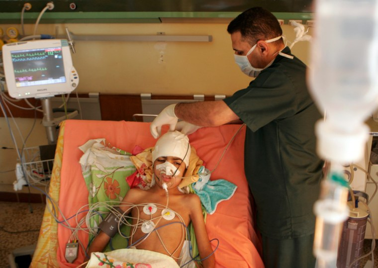 Image: Hiba Mohammed, an eight-year old Iraqi girl, is treated at a hospital in Baghdad
