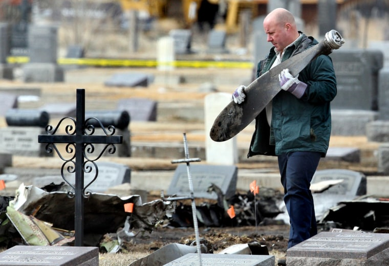 Image: NTSB investigators scour Holy Cross Cemetary
