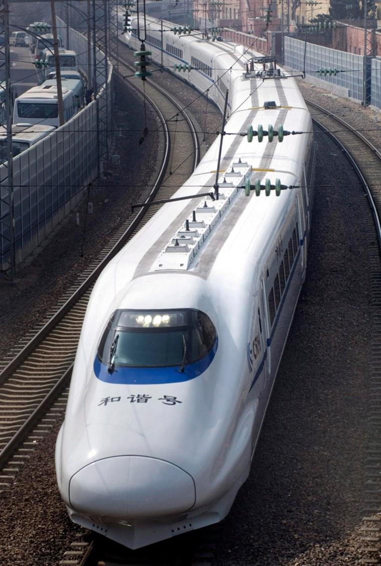 Image: A China Railway High-speed train travels through Qingdao city.