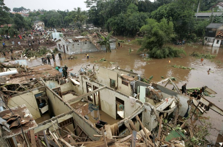 Image: A view of the damage after a flood on the outskirts of Jakarta
