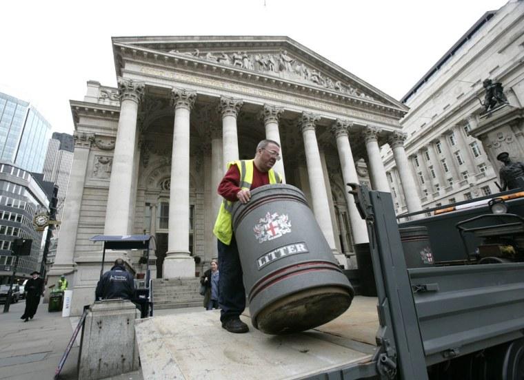 Image: A worker removes a litter bin