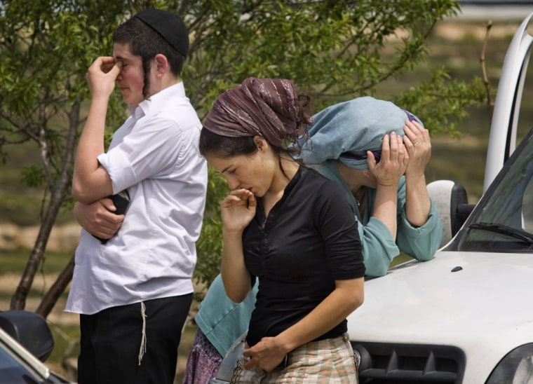 Image: Image: Jewish settlers mourn after attack in Jewish settlement of Bat Ayin