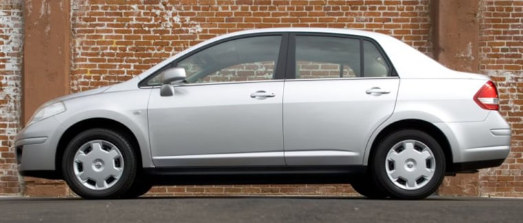 The base model of the Nissan Versa 1.6 has no vanity mirror. Oh, the humanity!