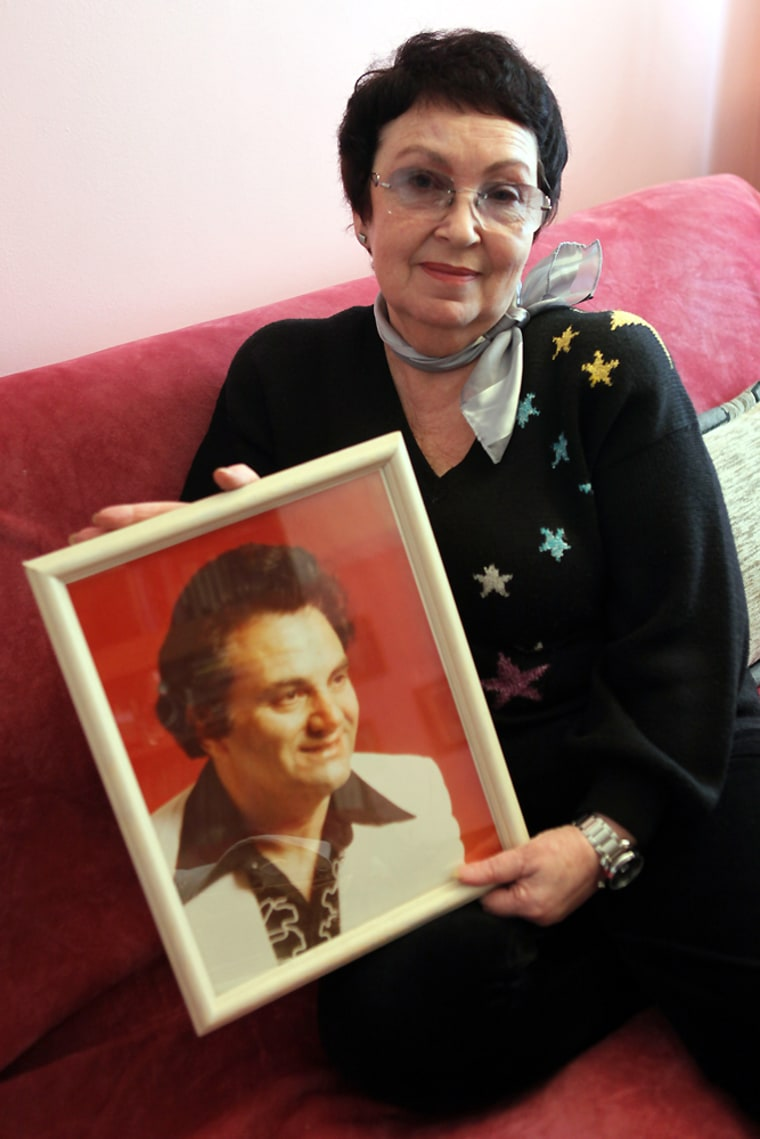 Irina Zayko Gorovets, a Russian immigrant and widow of U.S. citizen Emil Gorovets, poses with a picture of her late husband during an interview, Thursday, March 19, in New York. Emil Gorovets, a singer and composer died in 2001, a year after they were married but not long enough to guarantee her American citizenship.
