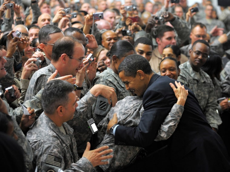Image: Barack Obama greets troops during a visit to Camp Victory