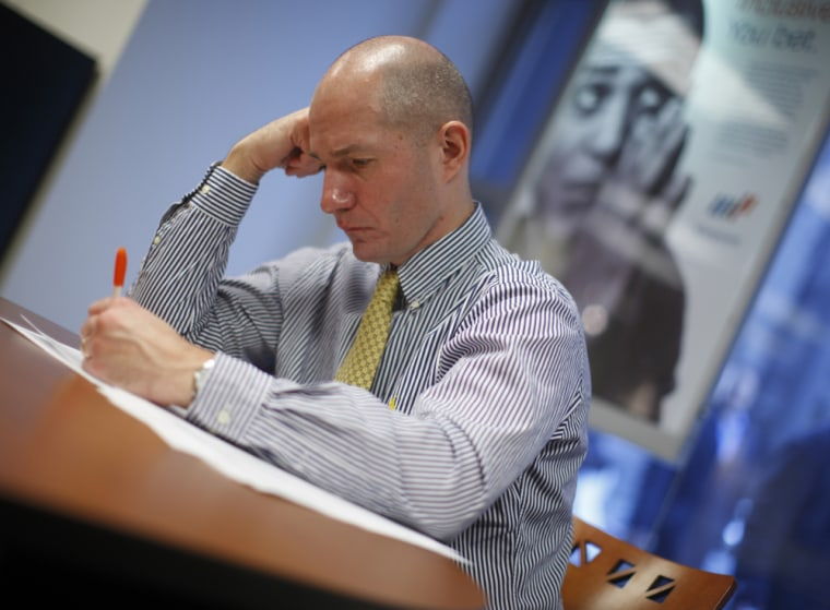 Craig Berry signs up for temporary work at a Manpower temporary agency in Chicago