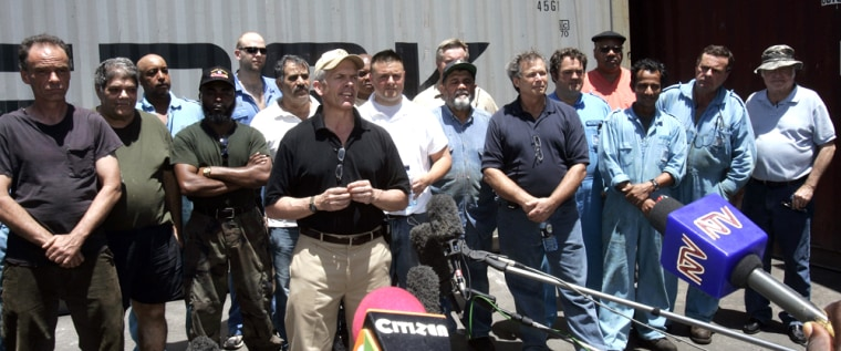 Image: Crew members of the American container ship Maersk Alabama speak to the media