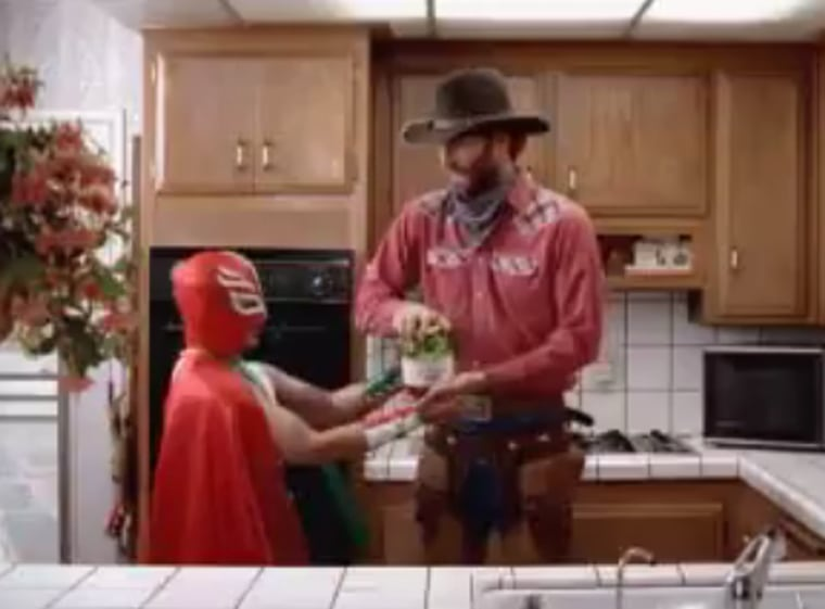 """This Burger King advertisement, which shows a wrestler in a caperesembling a Mexican flag and an American cowboy, has prompted a Mexican diplomat to complain the spot """"improperly"""" uses the """"stereotyped image of a Mexican."""""""