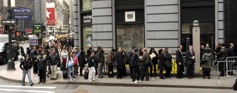 Image: People queue for a job fair in New York