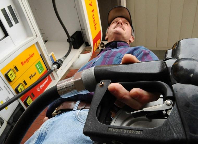 Image: Doug Kemp pumps gas