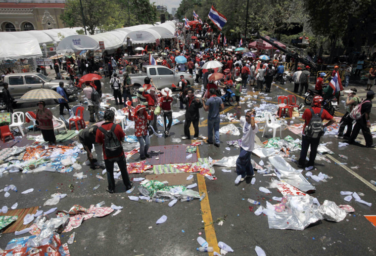 mage: Thai anti-government protesters leave the stage area after leaders called off their rally