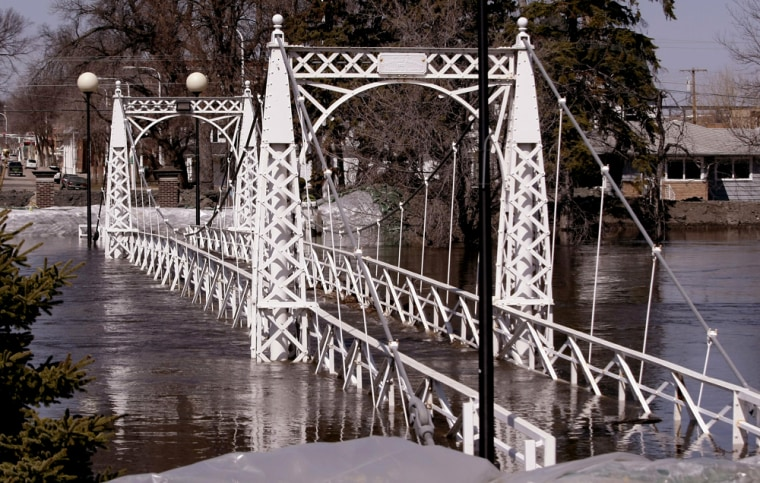 Image: foot bridge is flooded by the Sheyenne River
