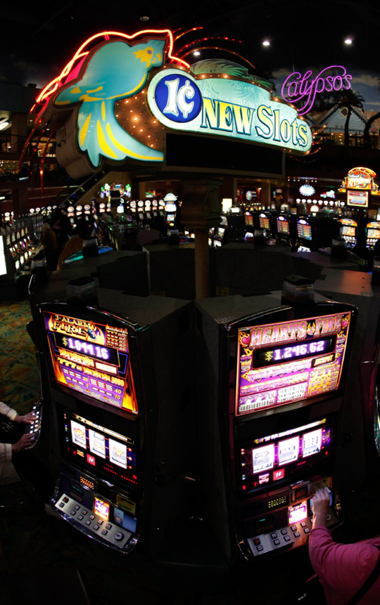 Patrons play a penny slot machine at the Isle Of Capri casino in Kansas City, Mo., on March 18.