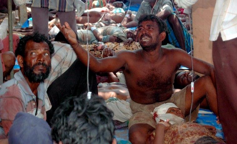 Image: Injured civilians are seen in a make-shift hospital in Putumatalan