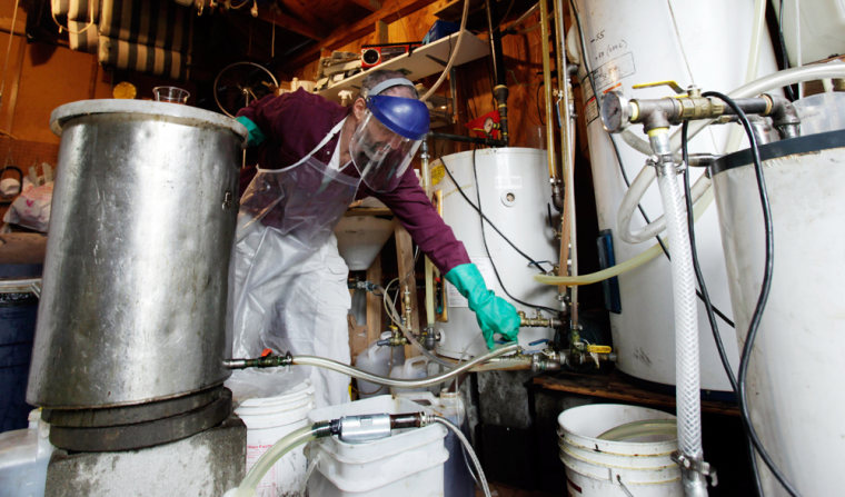 Lyle Rudensey refines homemade biodiesel from used cooking oil in his garage Wednesdayin Seattle.