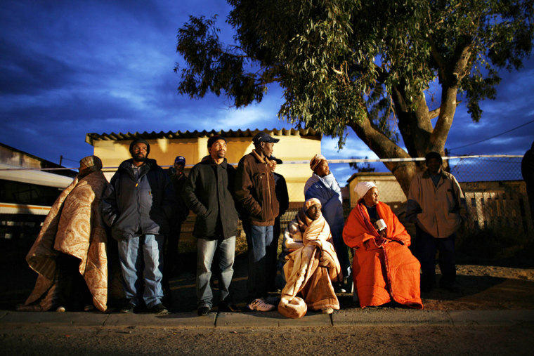 Image: South Africans wait for a polling station to open in Cape Town's Khayelitsha township