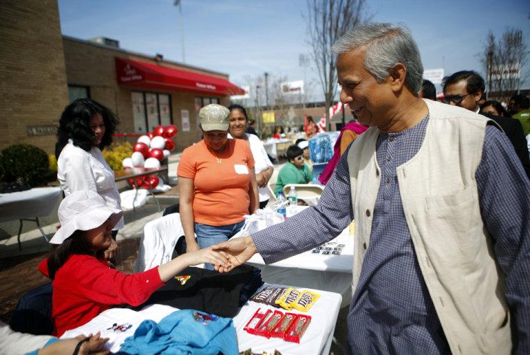 Image: Nobel Peace Prize winner Muhammad Yunus greets borrowers at a Granmeen America open house at St. John's University in New York