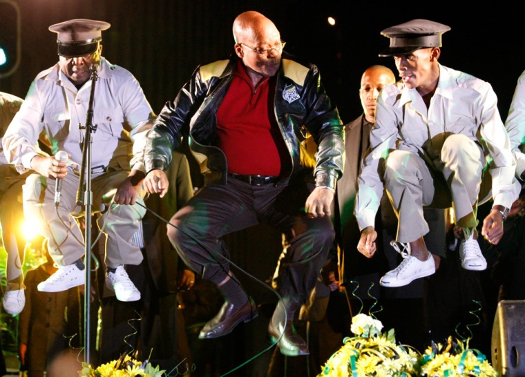 Image: ANC president, Jacob Zuma (C) jumps into the air as he dances on stage